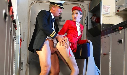 Beauty stewardess during the flight, gets fucked with the second pilot on Board the aircraft