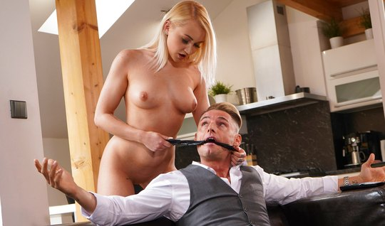 The blonde dominates the guy in the gray suit and sits down on his face