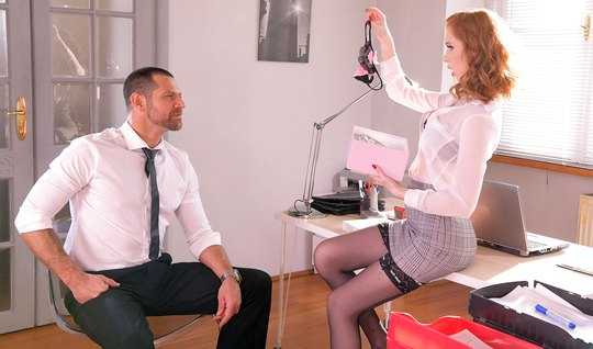 Redhead secretary in the office pounces on the boss's juicy cock and cums