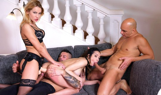 Group porn with strapon and double penetration on a soft couch