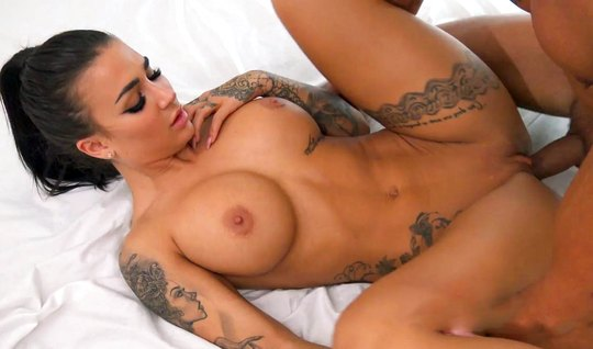 Brunette with big milkings on the bed substitutes a juicy whipping gap
