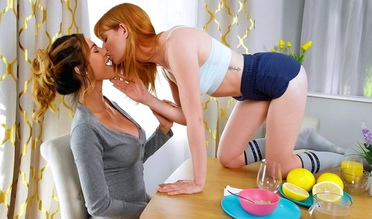 Redhead lesbian and her mommy right in the bedroom have oral sex