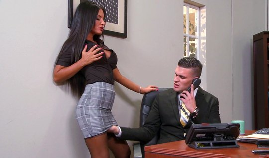 In the office, a girl in stockings enjoys sex right on the table and cums