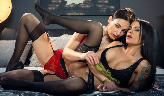 Two beautiful lesbians with tattoos and stockings finger each other