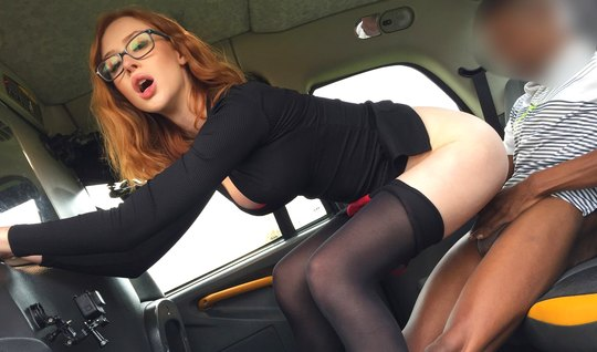 Redhead babe in stockings set a pilot for sex in a car with an excited black