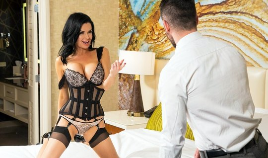 The nurse in lace lingerie undresses in front of a man and shakes booty