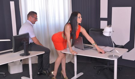 Busty Secretary fucked by boss right in the office