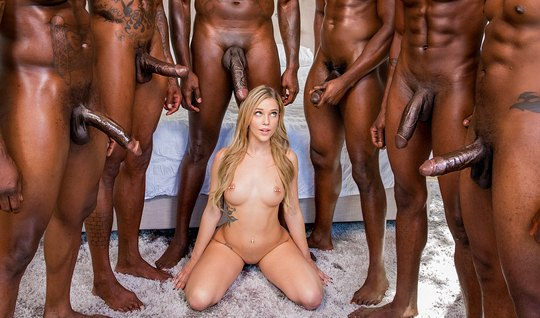 Slender blonde obkonchalsya from large members of blacks in group sex
