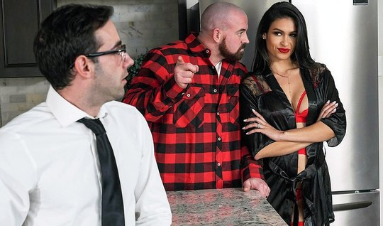 The brunette changed muscular man with his business friend on the kitchen table