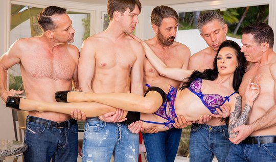 A crowd of men entertain the beauty of Gangbang and double penetration