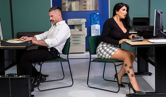 Brunette with big milkings and a tattoo on the body seduced co-worker sex in the office