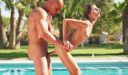 Skinny girl at the pool nature is engaged in classic sex