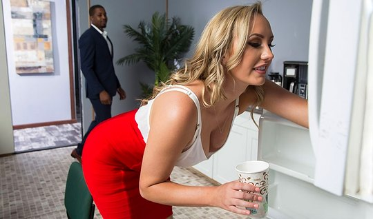 Blonde Secretary in stockings has sex with inflated Negro