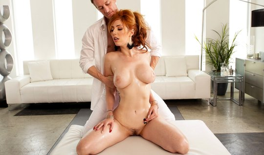 Redhead babe with big milkings receives powerful orgasm from sex