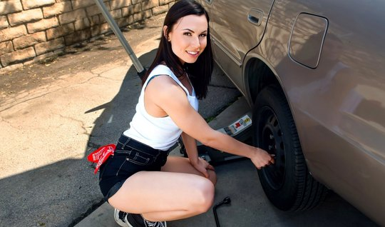 Brunette right on the hood of the car substitutes a hole for love