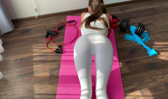 A skinny fit girl takes off her white leggings and takes a big dick of the instructor in her pussy