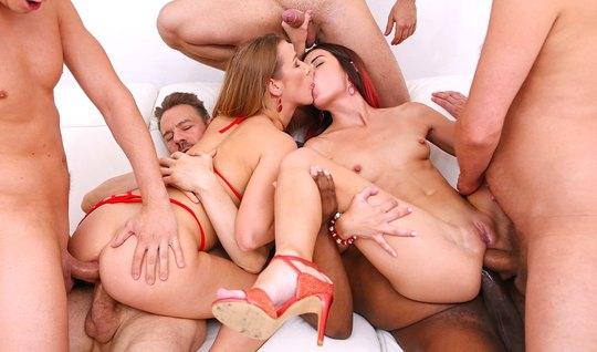 Girlfriends in an orgy double penetration with a crowd of muscular firefighters