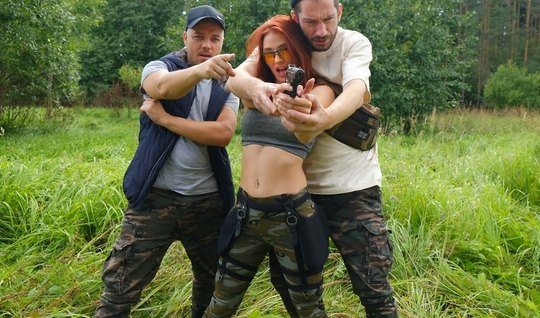 Redhead in nature with two hunters fucks cancer on green grass and cums