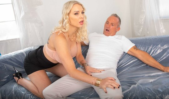 The blonde begins to eagerly suck the gray-haired man a long beautiful cock