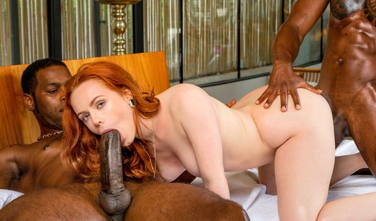 A red-haired girl and two blacks decided to arrange group porn in the bedroom